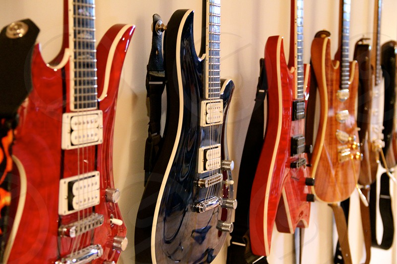 Just pick one - a collection of diverse guitars hang at the ready to be played.  photo