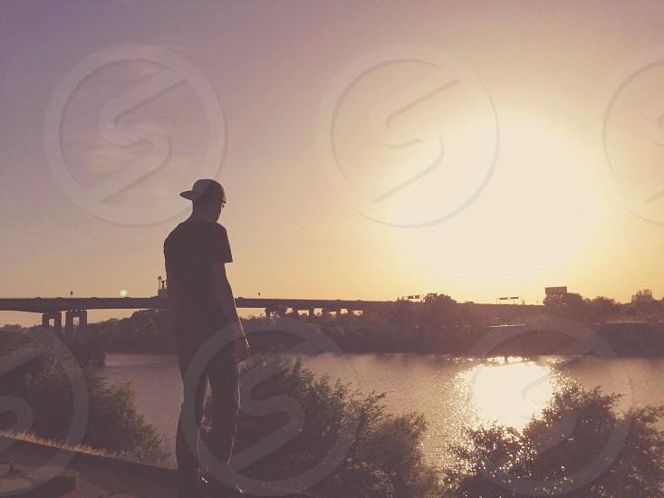 man facing lake photo
