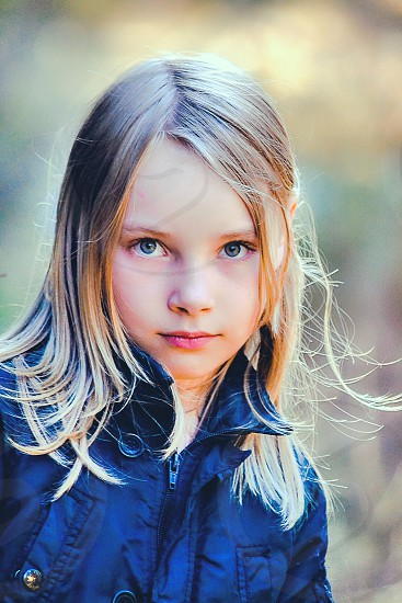 Beautiful young girl with an expressive face photo