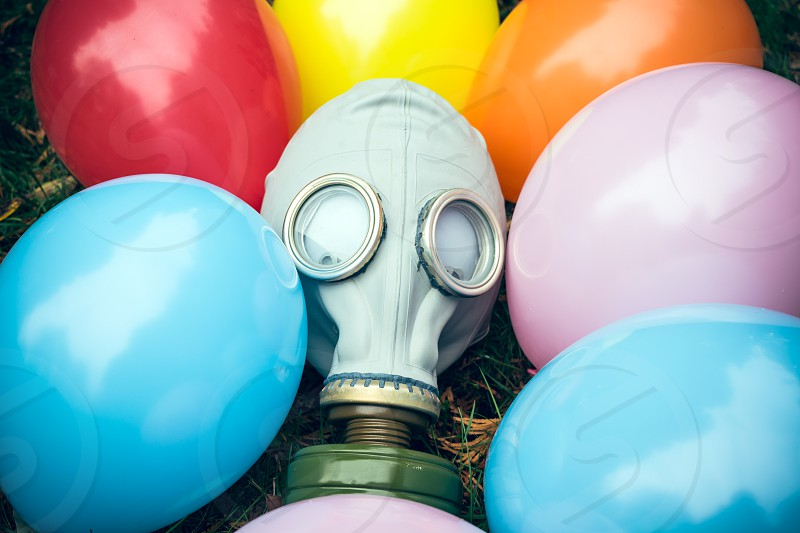 balloons breathing celebration colorful concept gas mask meadow party war fumes toxic gear military vintage festive birthday carnival holiday background safety fiesta festival multicolored anniversary photo