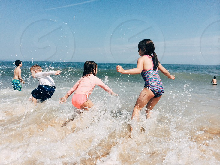 children playing on water photo