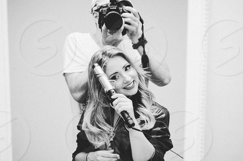 Couple man and woman get in ready woman man photographer hipster beauty taking photo mirror photographed 30s happiness smiling smile camera  photo