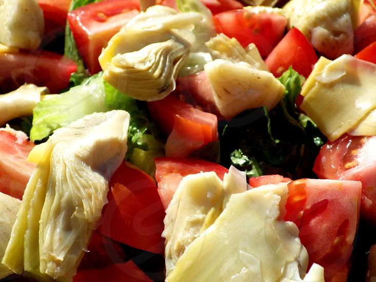 artichoke and tomato salad closeup photo