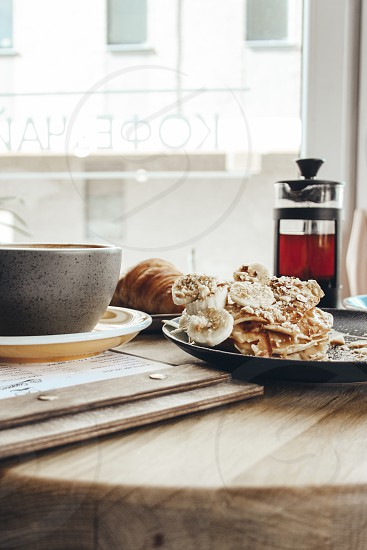 On the table pancakes cappuccino coffee tea French press cup of coffee food breakfast photo