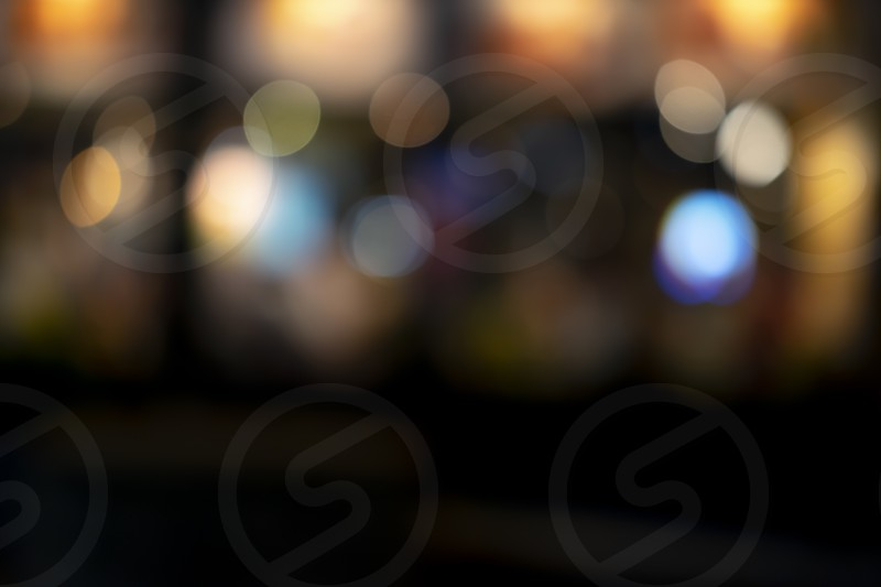 Blur bokeh background of city night light with vintage effect color. photo