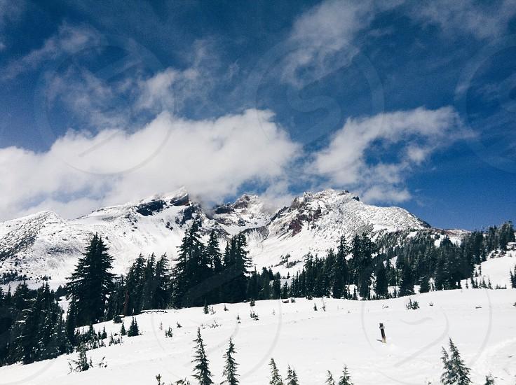 snowed mountain under white clouds during daytime photo