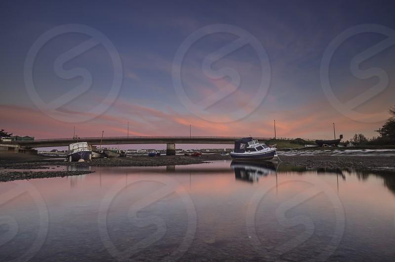 boats sunset sky water photo