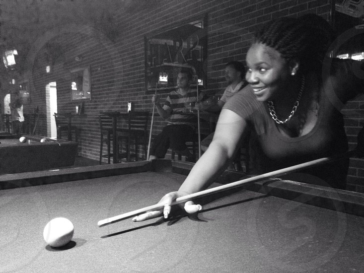 woman in scoop neck shirt playing billiard photo