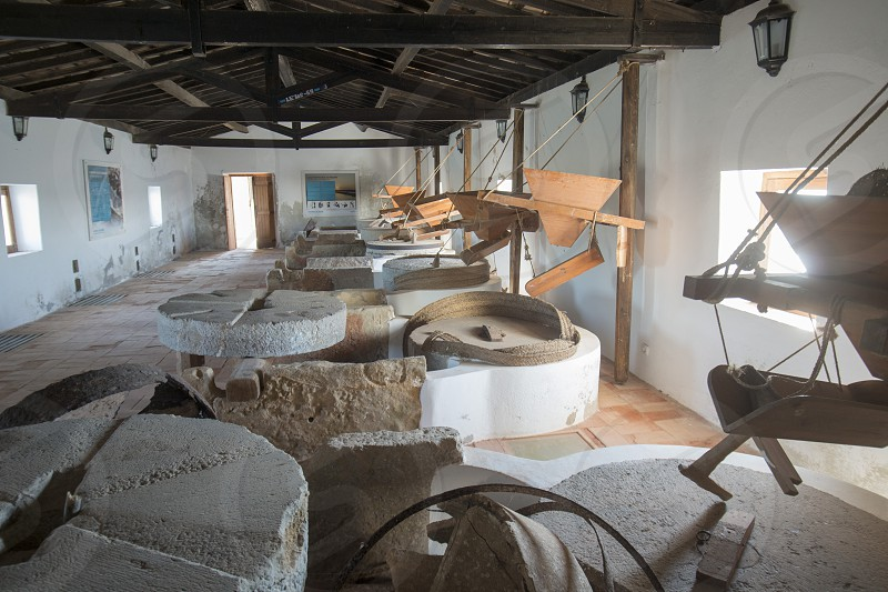 the water mill the natural Park of Quinta de marim of Ria Formosa near the Town of Olhao at the east Algarve in the south of Portugal in Europe. photo