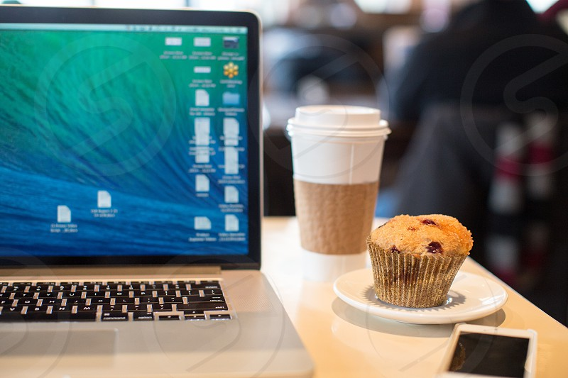 Mac laptop with coffee and muffin photo