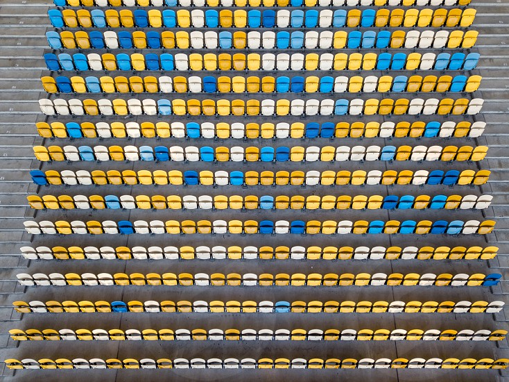 KIEV UKRAINE - July 19 2018. National Sports Complex Olimpiysky aerial view from drone to a tribune with blue and yellow colors in a summer time before match. photo