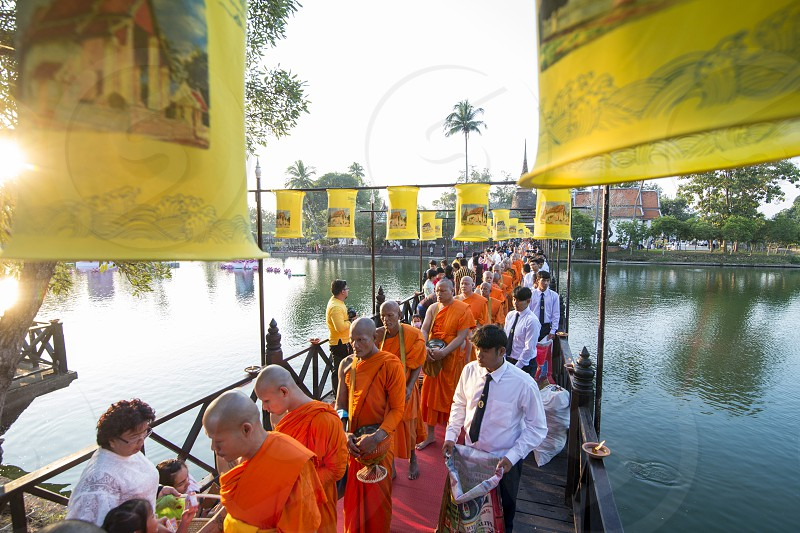 a buddhism Monk ceremony at the Loy Krathong Festival in the Historical Park in Sukhothai in the Provinz Sukhothai in Thailand.   Thailand Sukhothai November 2018 photo