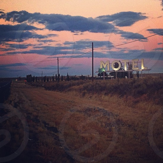 motel sign with gray cloud photo  photo