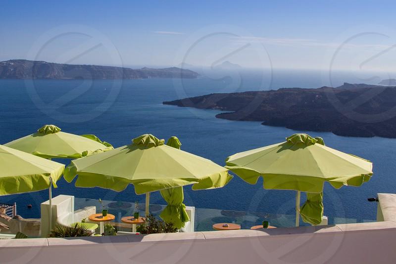 Colorful restaurant overlooking the Aegean Sea in Santorini Greece photo