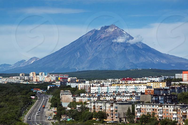 City landscape of Petropavlovsk-Kamchatsky and beautiful active Koryak Volcano on a sunny day. Far East Russia. photo