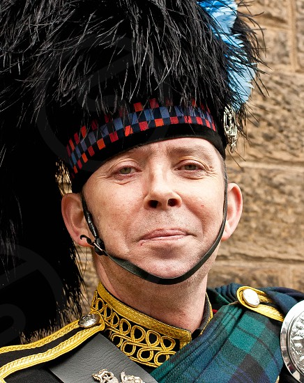 Portrait of a Scottish man in formal military uniform with headdress. photo