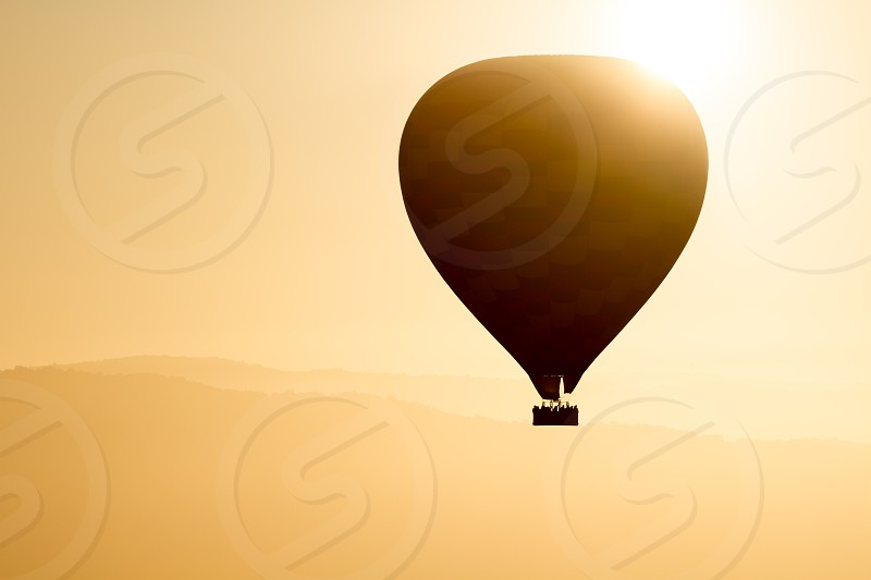 A hot air balloon silhouetted against the sunrise over Napa Valley California photo