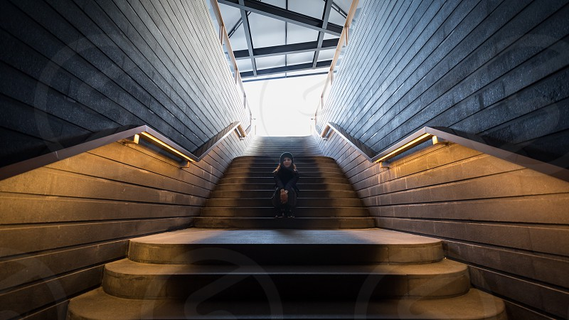 China Shanghai a women sitting on the illuminated staircase at the Fuxing museum photo