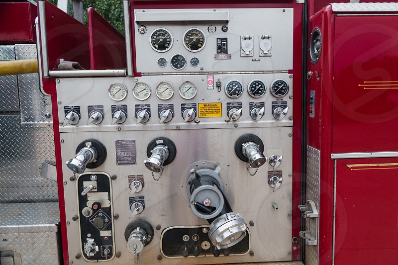 Ladder fire engine vehicle detail showing array of  gauges photo