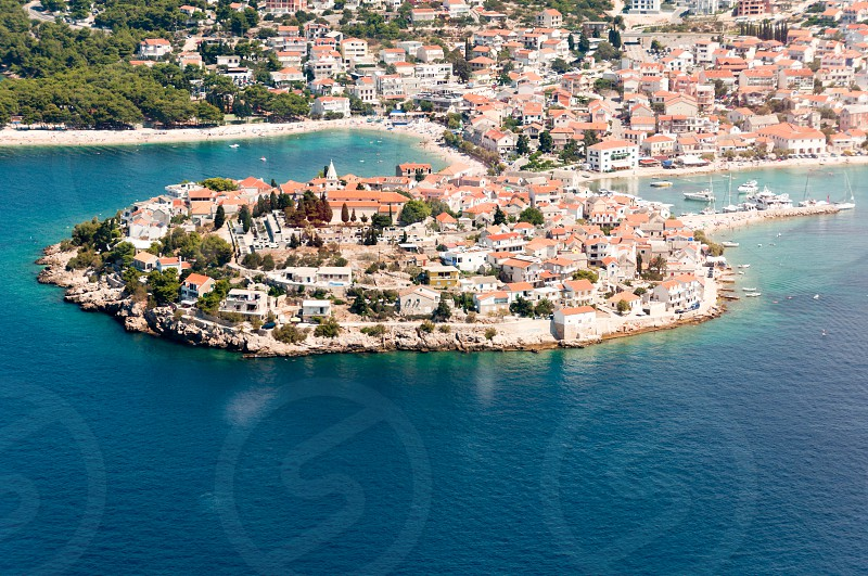 Aerial view of Primosten historic town on the Adriatic coast and popular Croatian summer destination. photo