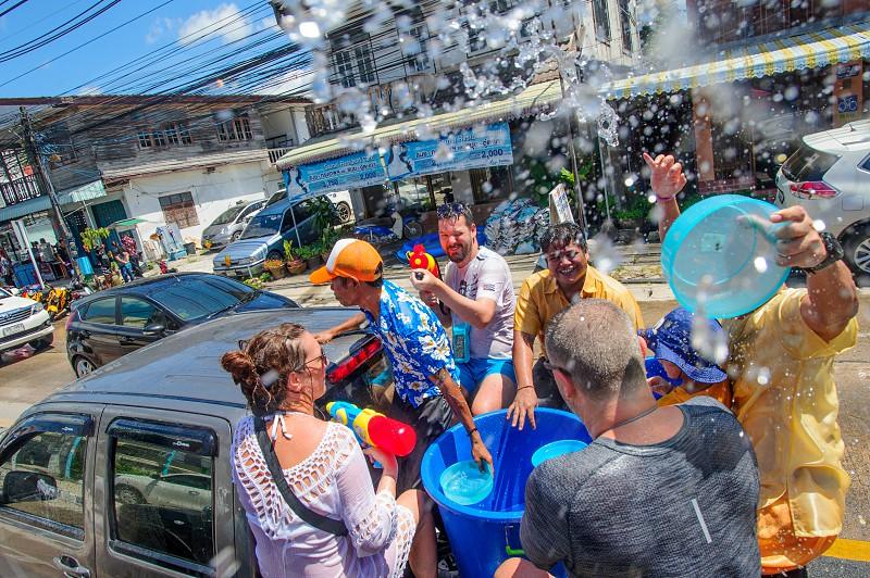 Koh Samui Thailand - April 13 2018: Songkran Party - the Thai New Year Festival. Familiar and unfamiliar people celebrating together. Water guns and fun all around the crowd. photo