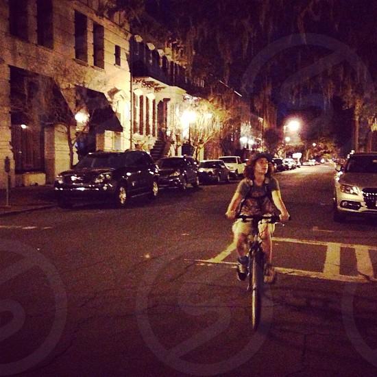 kid riding black mountain bike photo