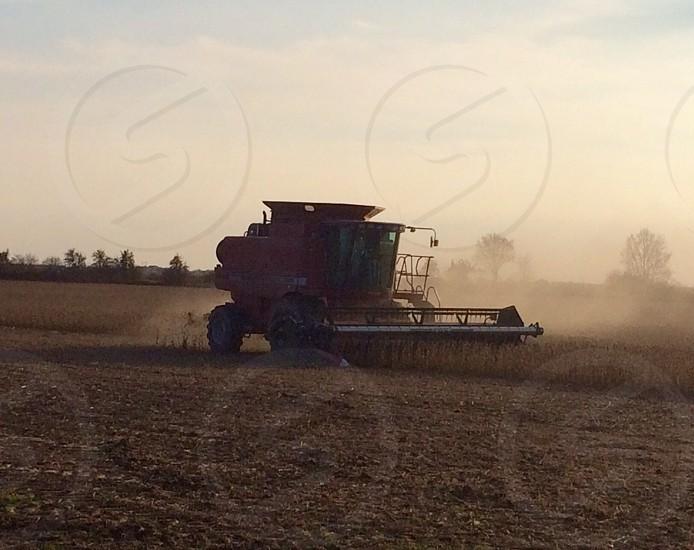 Farms Harvest Combine during Harvest photo