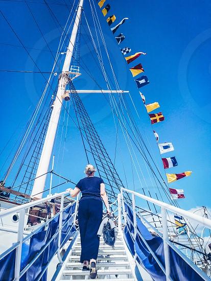 Cruise season person unrecognizable person woman flags ship travel signal flags photo