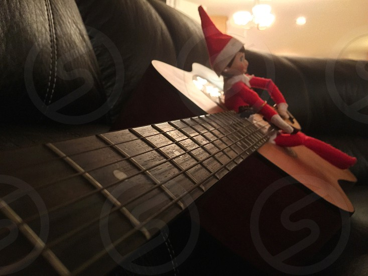 Evie is paying the guitar tonight waiting until morning to see my daughter  photo