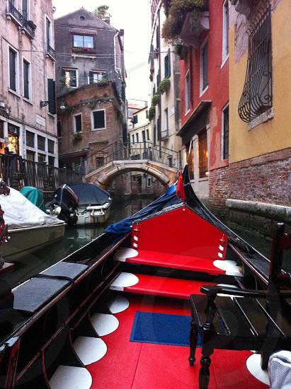 Empty seats on gondola - Venice Italy. photo