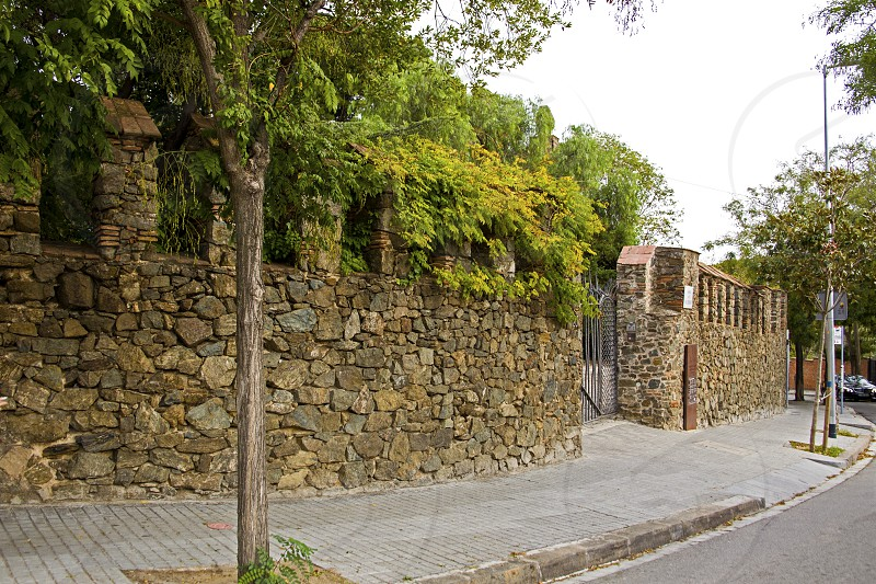 entrance from street in Torre Bellesguard - the palace built by Gaudi. photo