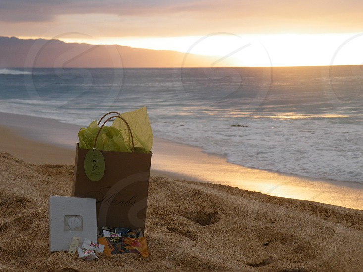 wedding gift bag on beach at sunset photo