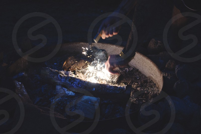 Starting a fire the old fashioned way. photo