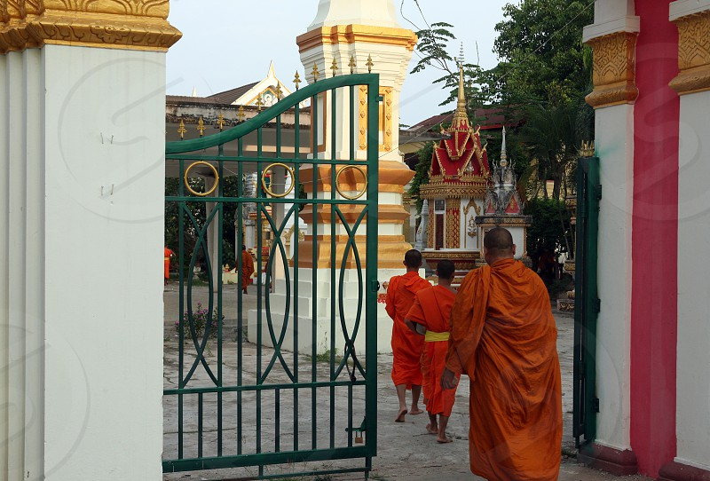 the monk in the morning at the Tempel Wat Sainyaphum on a road in the town of Savannakhet in central Lao in the region of Khammuan in Lao in Souteastasia. photo