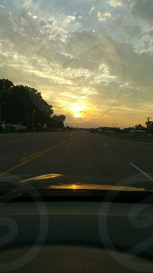 The long drive homeinto the sunset.. photo