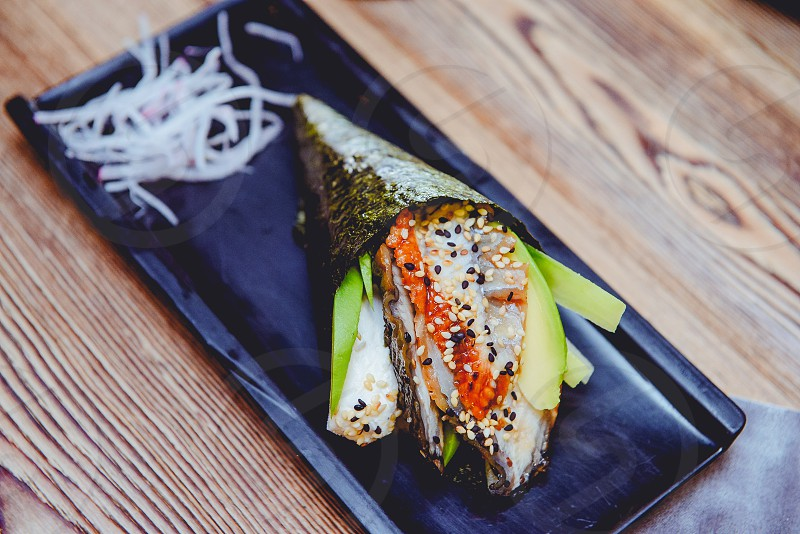 Temaki roll on a wood table at SRM photo