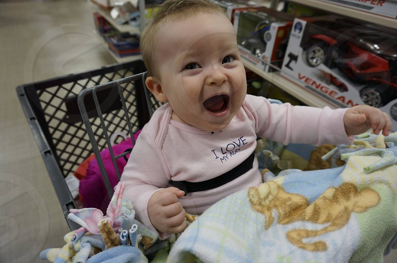 Happy baby at the store cart photo