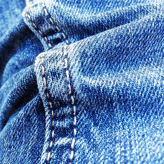 macro of blue jeans textures photo
