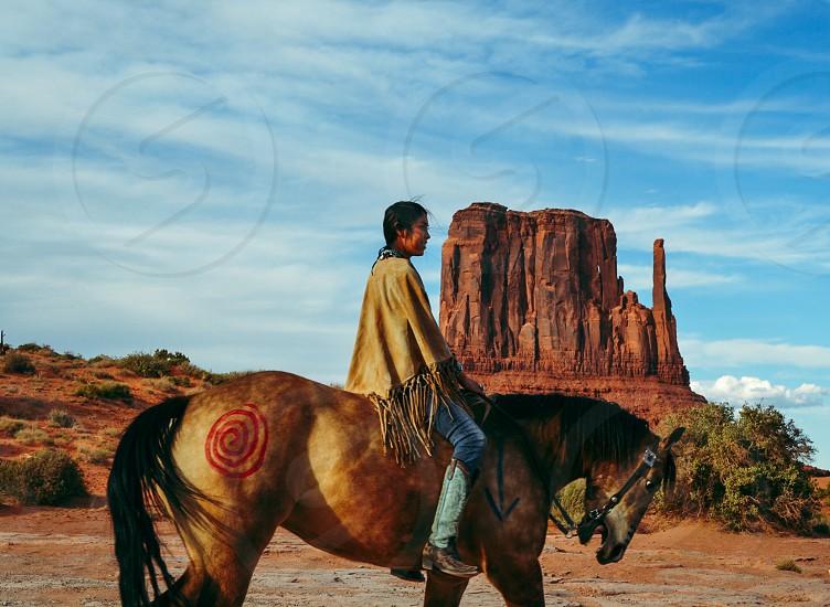 Navajo girl on a horse photo