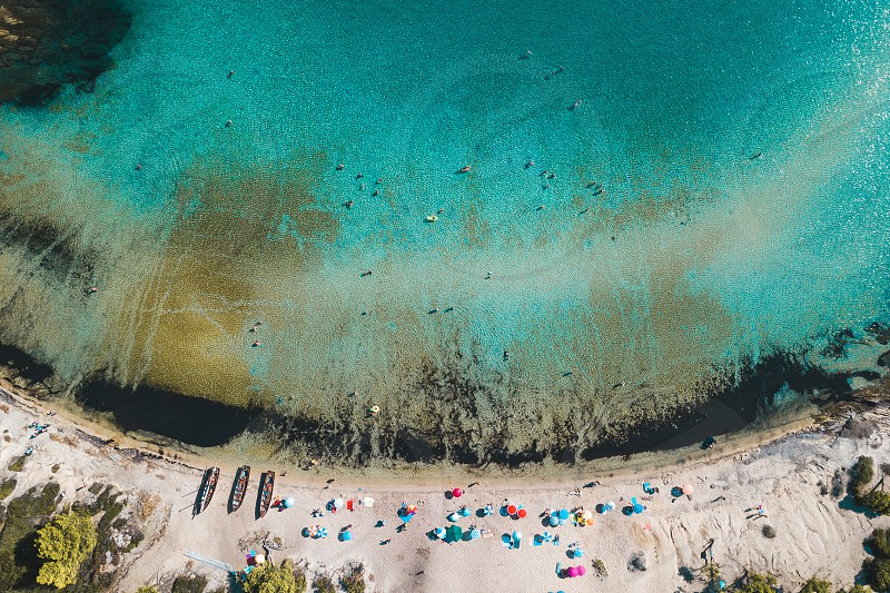 Aerial view of the tropical beach full of people photo