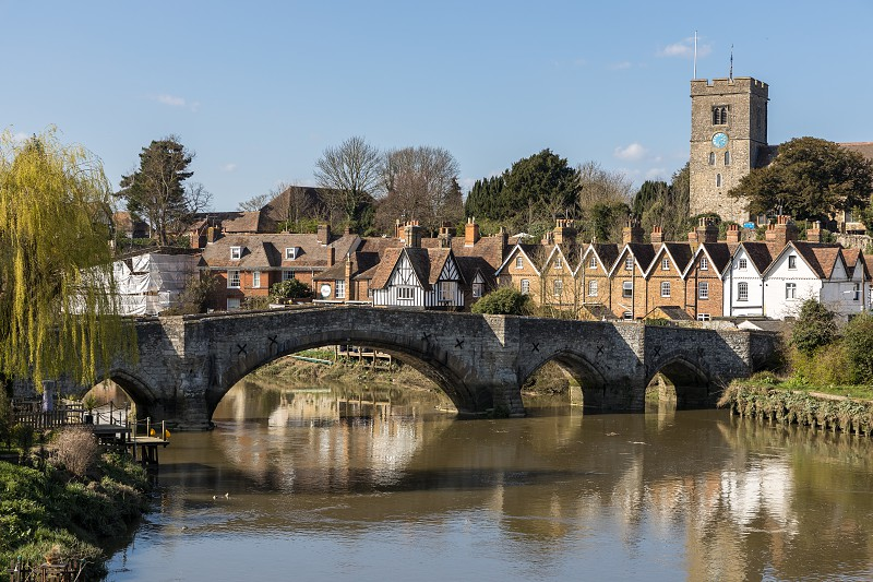 AYLESFORD KENT/UK - MARCH 24 : View of the 14th century bridge and St Peter's church at Aylesford on March 24 2019 photo
