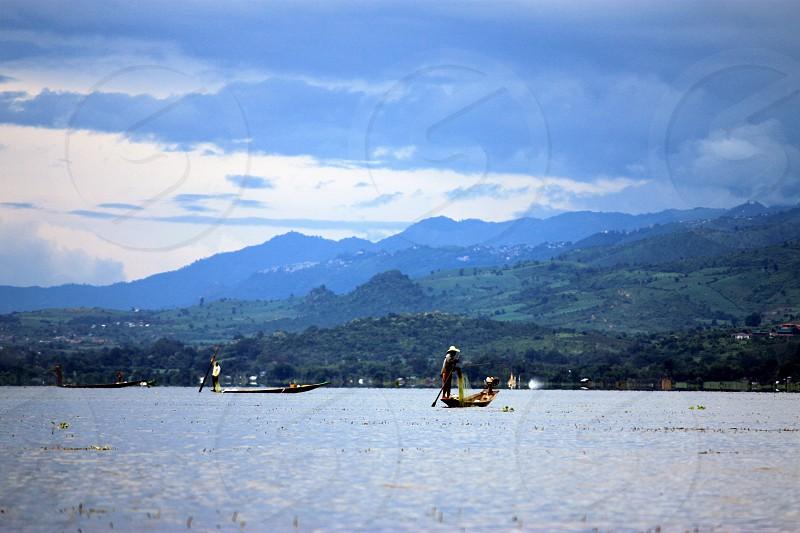lake fishermen dusk myanmar asia inle lake photo
