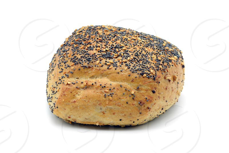 traditional german bread roll with poppy seeds and sesame corns on white isolated background photo