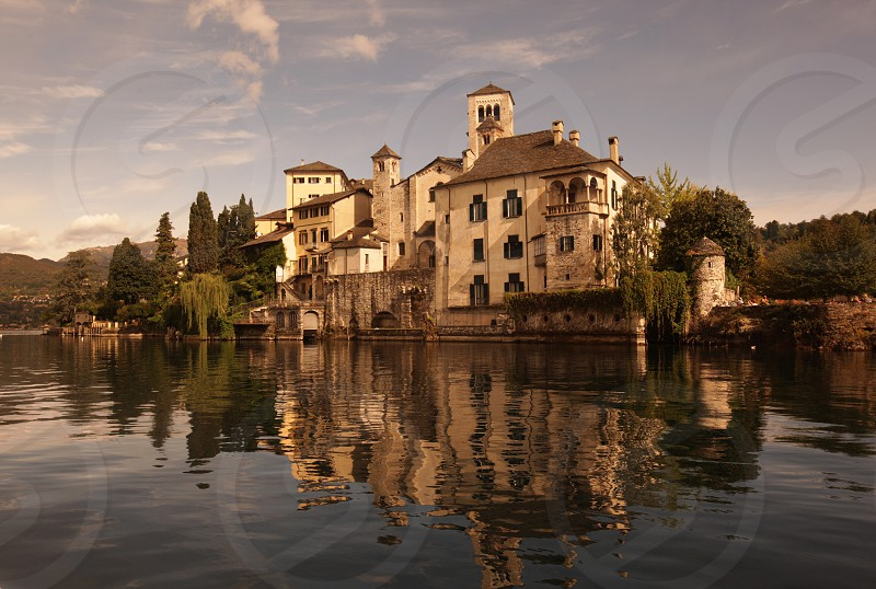 The church of Isola San Giulio in the Ortasee outside of the Fishingvillage of Orta on the Lake Orta in the Lombardia  in north Italy.  photo