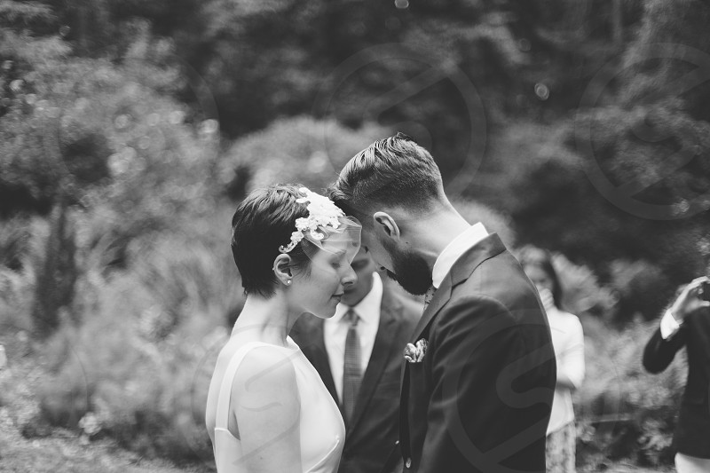 wedding couple standing in front of each other during daytime photo