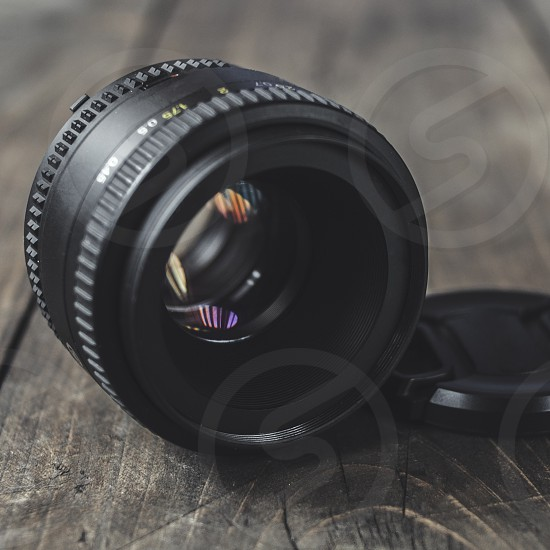 Old lens with color reflection photo