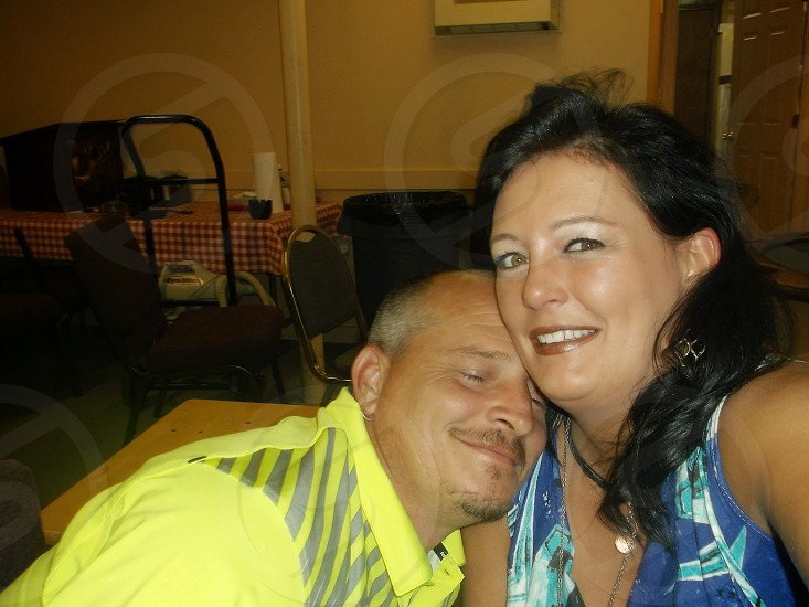 loving couple inside poker room together happy good times photo