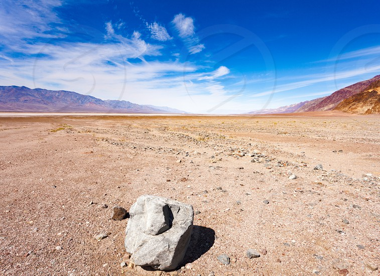 Badwater Basin of Panamint Valley lowest point below sea level of Death Valley desolate arid desert landscape in Death Valley National Park California CA USA photo