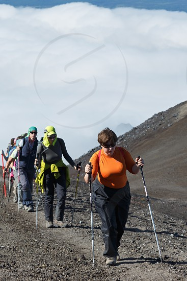 AVACHINSKY VOLCANO KAMCHATKA PENINSULA RUSSIAN FAR EAST - AUGUST 7 2014: Hiking on Kamchatka - group of women travelers and tourists climbing on tourist trail to top of Avacha Volcano on Kamchatka Peninsula. photo