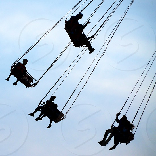 people riding in a swing photo